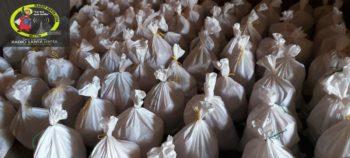 Tres mil familias reciben paquetes alimenticios por parte de la iglesia católica